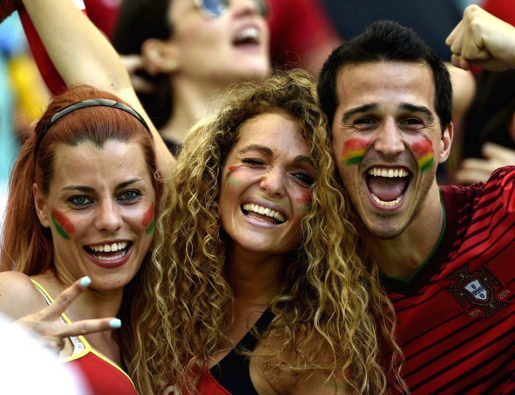 Fans of team Portugal cheer before a Group G match between Germany and Portugal of 2014 FIFA World Cup at the Arena Fonte Nova Stadium in Salvador, Brazil, June ...