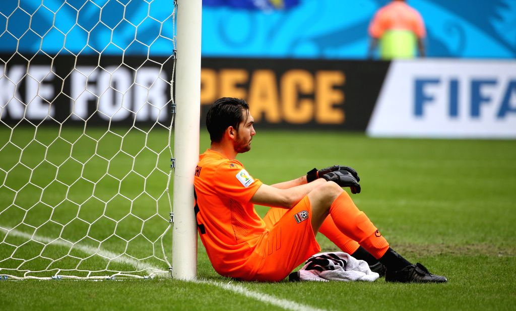 Iran's goalkeeper Alireza Haghighi reacts after a Group F match between Bosnia And Herzegovina and Iran of 2014 FIFA World Cup at the Arena Fonte Nova Stadium in ..