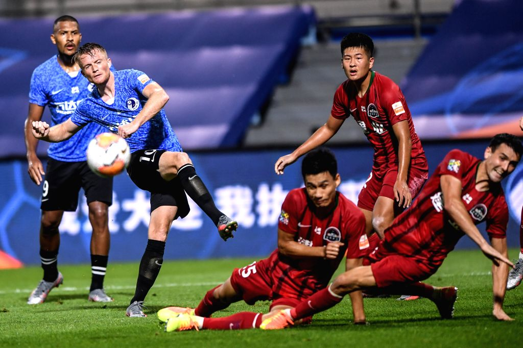 Sam Larsson (2nd L) of Dalian Yifang FC shoots during the second round match between Dalian Yifang FC and Henan Jianye FC at the postponed 2020 season Chinese ...