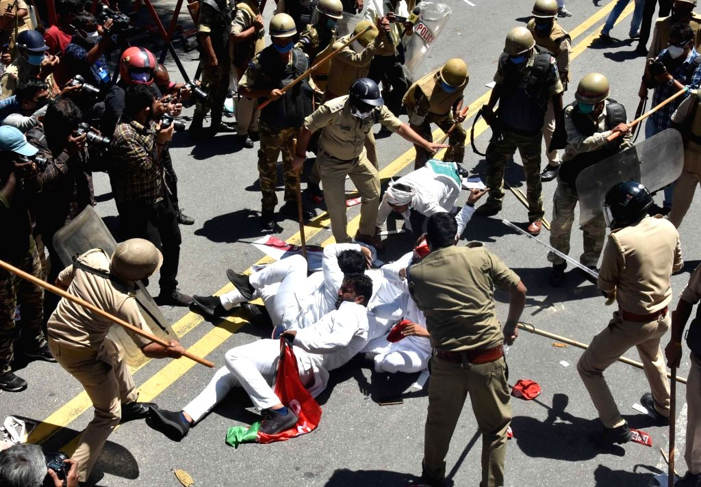 Samajwadi Party activists being baton-charged before being detained by police personnel during their protest demanding the postponement of National Eligibility-cum-Entrance Test (NEET) and ...