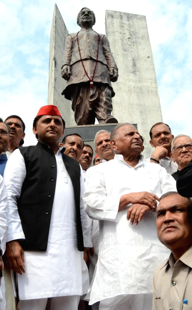 Samajwadi Party chief Akhilesh Yadav and his father Mulayam Singh Yadav during a programme organised on 50th death anniversary of socialist ideologue Ram Manohar Lohia in Lucknow on Oct 12, ... - Akhilesh Yadav and Mulayam Singh Yadav