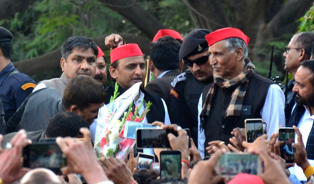 Samajwadi Party chief Akhilesh Yadav arrives in Prayagraj to meet the family members of Mahesh Kumar Yadav, a CRPF trooper martyred in the 14 Feb Pulwama terror attack; on Feb 23, 2019. - Akhilesh Yadav and Mahesh Kumar Yadav