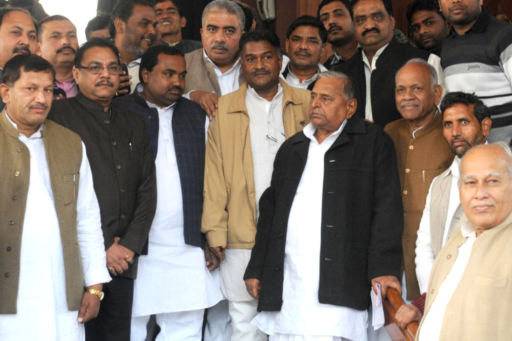 Samajwadi Party chief Mulayam Singh Yadav with other parliamentarians at the Parliament House after Lokpal Bill was passed in the Lok Sabha in New Delhi on Dec.18, 2013.