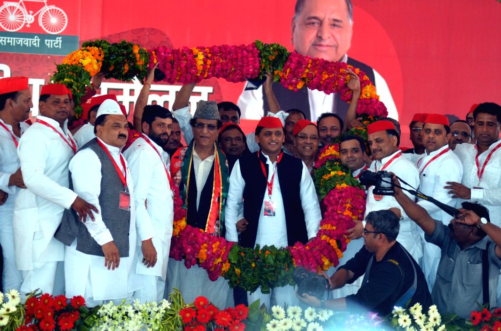 Samajwadi Party leaders including Azam Khan with Akhilesh Yadav who was re-elected unopposed as the national president of the party for a five-year term during party's national convention in ... - Azam Khan and Akhilesh Yadav