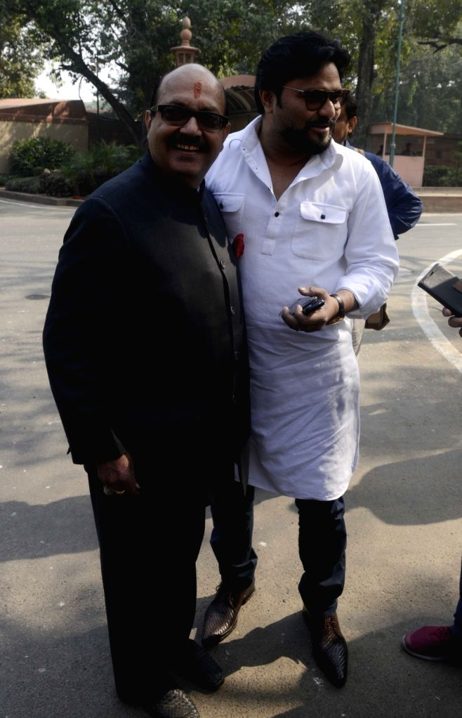 Samajwadi Party MP Amar Singh with  Union minister Babul Supriyo at Parliament House on Nov. 18, 2016. - Babul Supriyo and Amar Singh