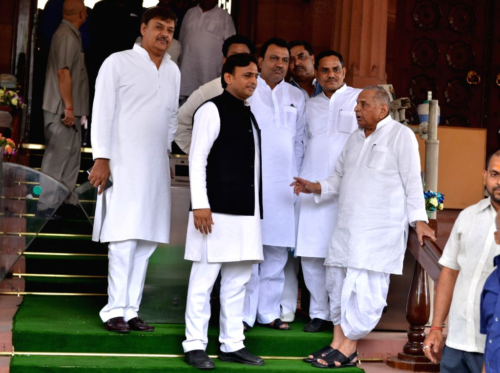 Samajwadi Party MPs Mulayam Singh Yadav and Akhilesh Yadav at Parliament in New Delhi on June 17, 2019. - Mulayam Singh Yadav and Akhilesh Yadav