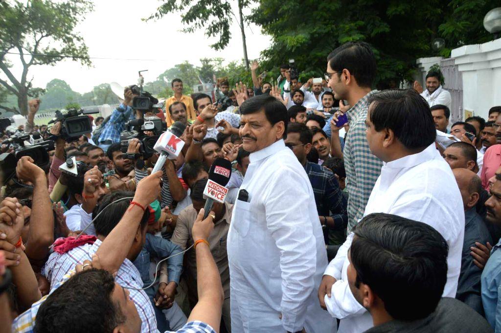 Samajwadi Party party leader Shivpal Singh Yadav talks to press after meeting party chief Mulayam Singh Yadav in Lucknow on Sept 16, 2016. Mulayam Singh Yadav on Friday met Uttar Pradesh ... - Akhilesh Yadav, Shivpal Singh Yadav and Mulayam Singh Yadav