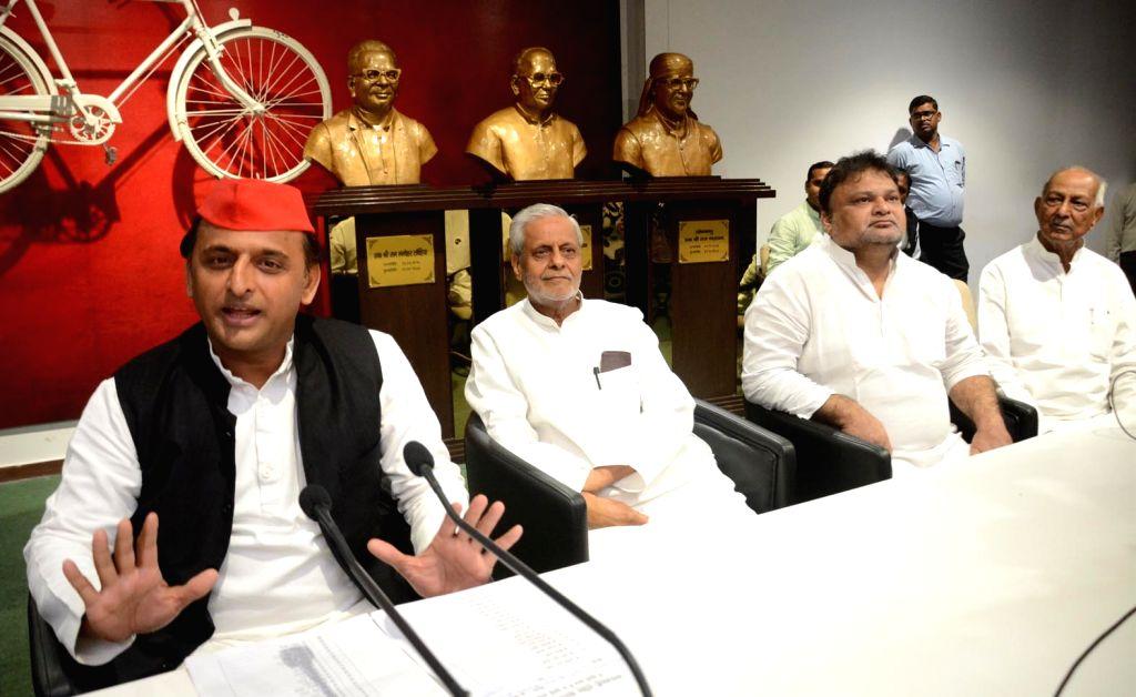 Samajwadi party president Akhilesh Yadav addresses at a party meeting, in Lucknow on July 16, 2018. - Akhilesh Yadav