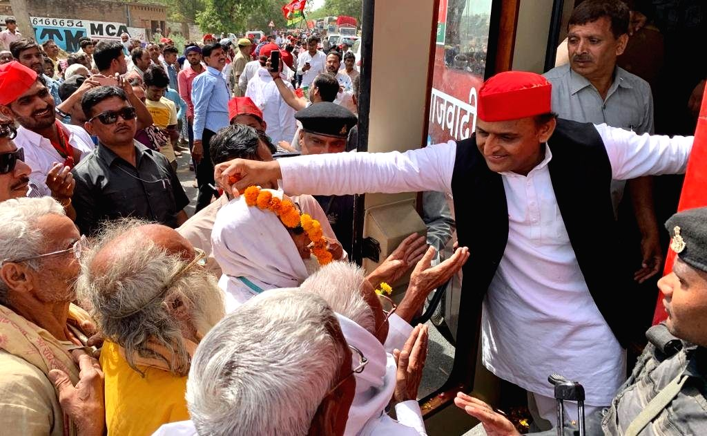Samajwadi Party President Akhilesh Yadav reaches out to the party's supporters during a roadshow ahead of the 2019 Lok Sabha elections in Uttar Pradesh's Kannauj on April 27, 2019. Kannauj is one of the thirteen constituencies in Uttar Pradesh that w - Akhilesh Yadav