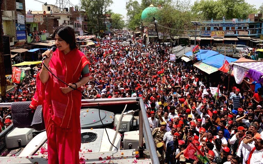 Samajwadi Party's Lok Sabha candidate from Kannauj Dimple Yadav addresses during a roadshow ahead of the 2019 Lok Sabha elections in Uttar Pradesh's Kannauj on April 27, 2019. Kannauj is one of the ... - Kannauj Dimple Yadav