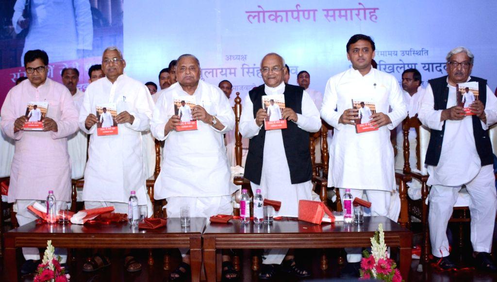 Samajwadi Party supremo Mulayam Singh Yadav and Uttar Pradesh Chief Minister Akhilesh Yadav during a programme to mark 70th birthday of his brother Ram Gopal Yadav and release of his book ... - Akhilesh Yadav, Mulayam Singh Yadav and Gopal Yadav