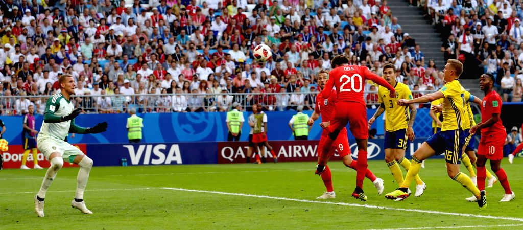 SAMARA, July 7, 2018 - Dele Alli (3rd L) of England heads the ball to score during the 2018 FIFA World Cup quarter-final match between Sweden and England in Samara, Russia, July 7, 2018.