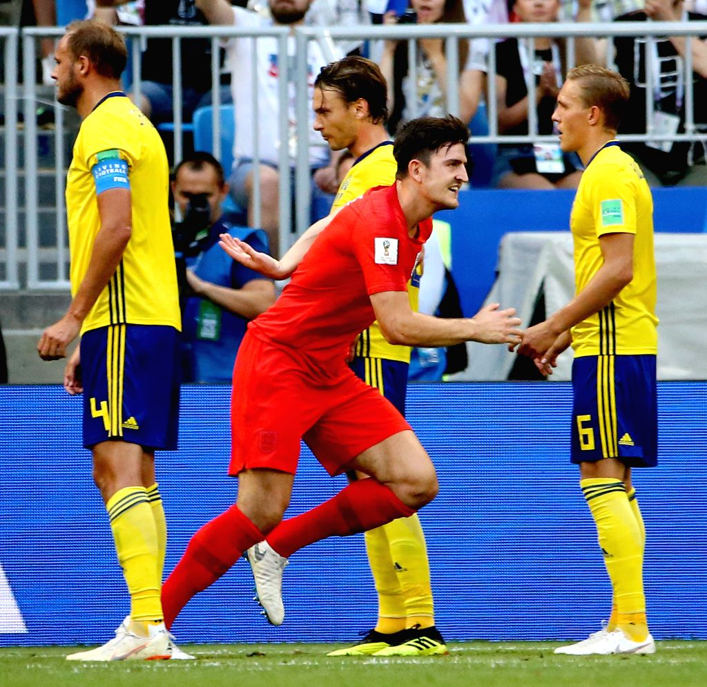 SAMARA, July 7, 2018 - Harry Maguire (front) of England celebrates scoring during the 2018 FIFA World Cup quarter-final match between Sweden and England in Samara, Russia, July 7, 2018.