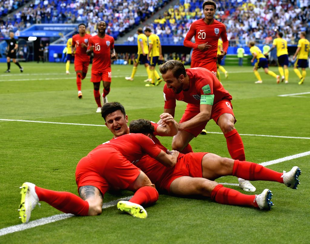 SAMARA, July 7, 2018 - Harry Maguire of England celebrates scoring with teammates during the 2018 FIFA World Cup quarter-final match between Sweden and England in Samara, Russia, July 7, 2018.