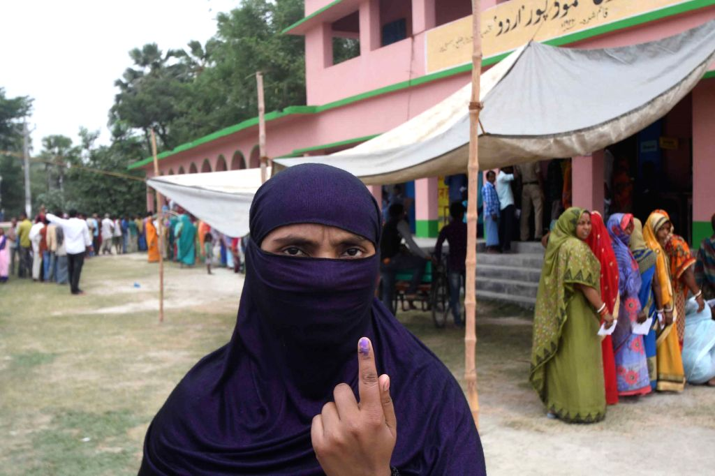 Samastipur: A woman shows her inked finger after casting her vote for the fourth phase of 2019 Lok Sabha elections in Bihar's Samastipur, on April 29, 2019. (Photo: IANS)
