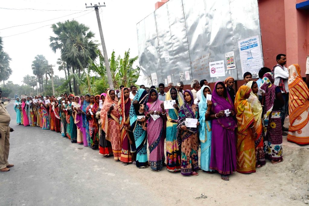 Samastipur: Voters queue up at a polling station to cast their votes for the fourth phase of 2019 Lok Sabha elections in Bihar's Samastipur, on April 29, 2019. (Photo: IANS)