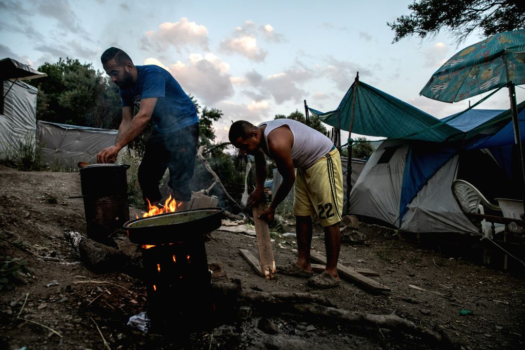 SAMOS (GREECE), May 27, 2019 A group of Palestinian refugees prepare their dinner at the refugee camp on Samos, an island in the eastern Aegean, Greece, on May 23, 2019. Four years after ...