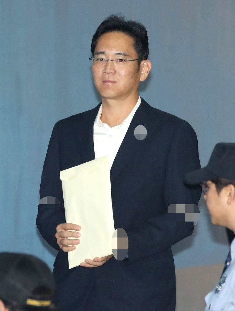 Samsung Electronics Vice Chairman Lee Jae-yong arrives at a high court in Seoul on Oct. 12, 2017, to attend the first hearing of an appeal trial on alleged bribery. In late August, Lee was ...