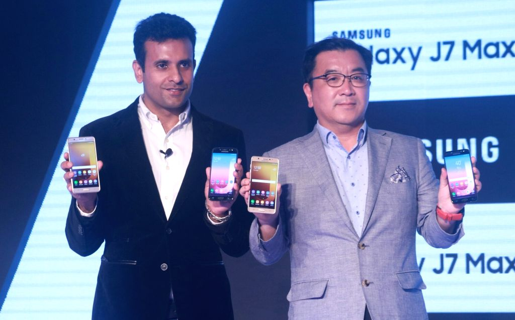 Samsung India Director (Mobile Business) Sumit Walia with MD & Head Mobile Business Ken Kang at the launch of Samsung Galaxy J7 Max and Galaxy J7 Pro in New Delhi, on June 14, 2017.