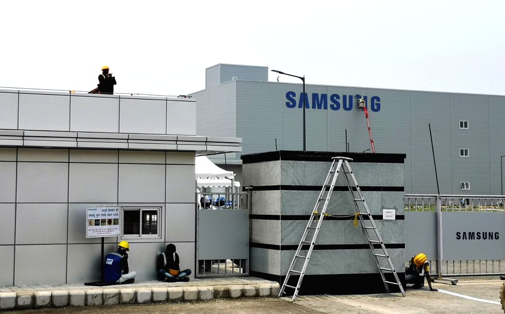 Samsung India Electronics's manufacturing facility in Block B, Sector 81, Noida that has now become the world's largest mobile factory; on July 7, 2018. Prime Minister Narendra Modi and South ... - Narendra Modi