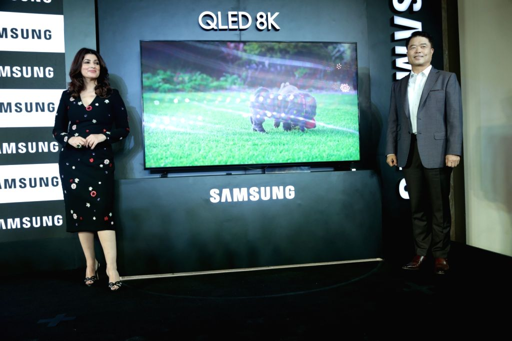 Samsung Southwest Asia President and CEO H.C. Hong and actress Twinkle Khanna at the launch of Samsung QLED 8K TV, in New Delhi on June 4, 2019. - Twinkle Khanna