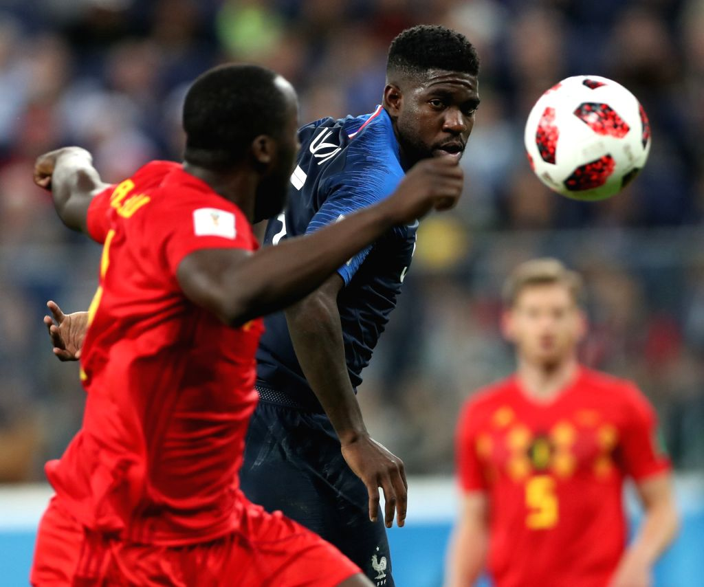 Samuel Umtiti (R) of France competes during the 2018 FIFA World Cup semi-final match between France and Belgium in Saint Petersburg, Russia, July 10, 2018. ...