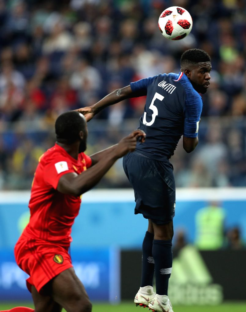 Samuel Umtiti (R) of France competes for a header during the 2018 FIFA World Cup semi-final match between France and Belgium in Saint Petersburg, Russia, ...