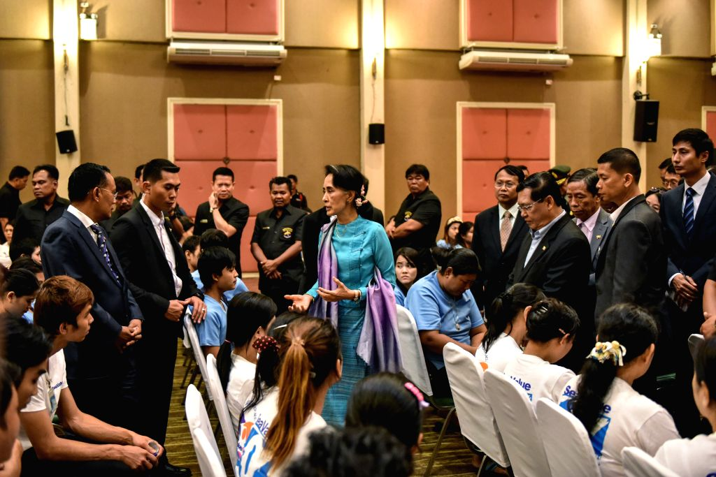 SAMUT SAKHON, June 23, 2016 - Myanmar State Counselor and Foreign Minister Aung San Suu Kyi (C) talks with Myanmar migrant worker representatives in Samut Sakhon province, Thailand, June 23, 2016. ... - Aung San Suu Kyi