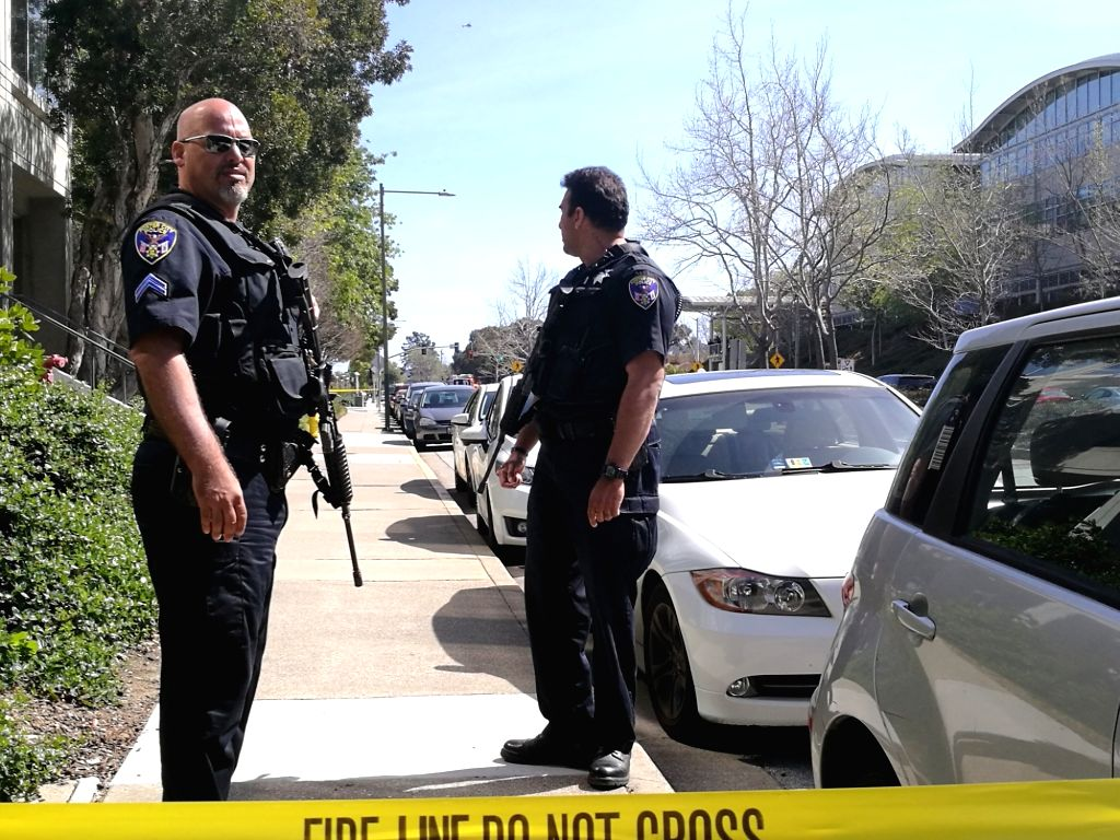 SAN BRUNO (U.S.), April 3, 2018 Police officers stand guard near the headquarters of YouTube in San Bruno, California, the United States, April 3, 2018. Police in north California are ...