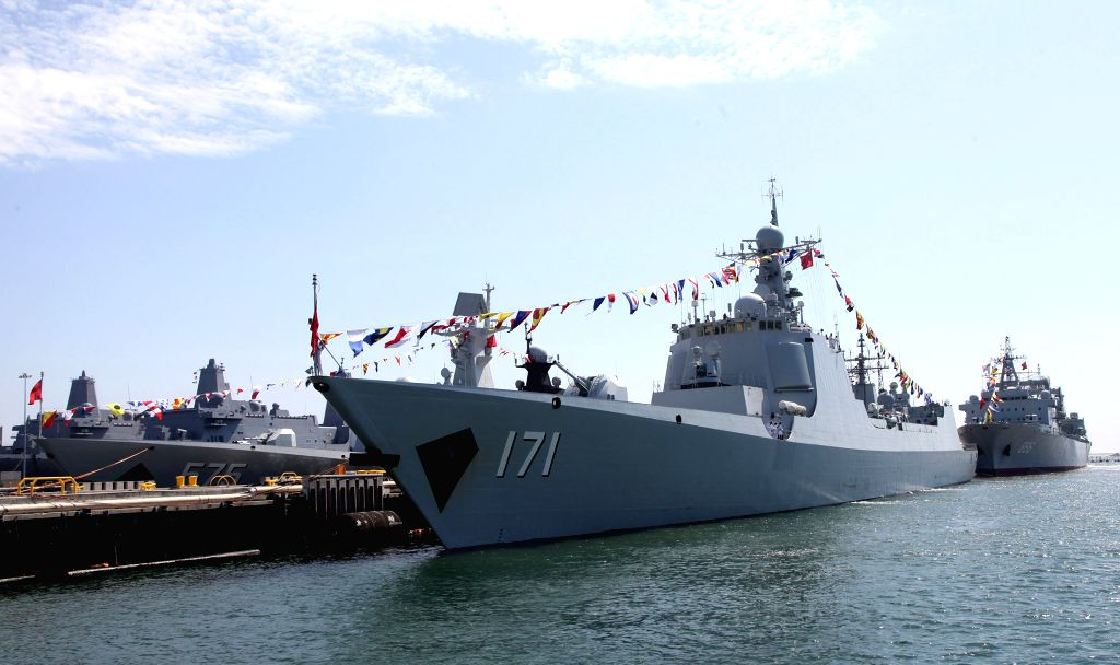 Chinese navy's Task Group 171, which include missile destroyer Haikou, missile frigate Yueyang and supply ship Qiandaohu, with a ship-borne helicopter and more ...
