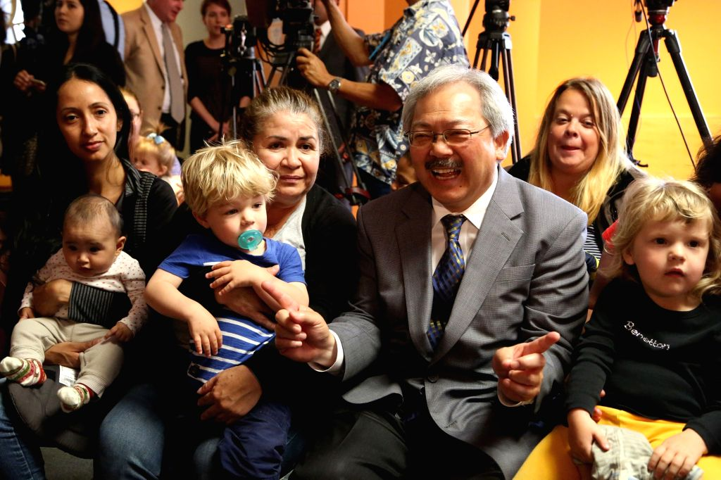 SAN FRANCISCO, April 22, 2016 - San Francisco Mayor Ed Lee interacts with mothers and children after signing a fully paid parental leave ordinance at the Children's Center of San Francisco's Main ...