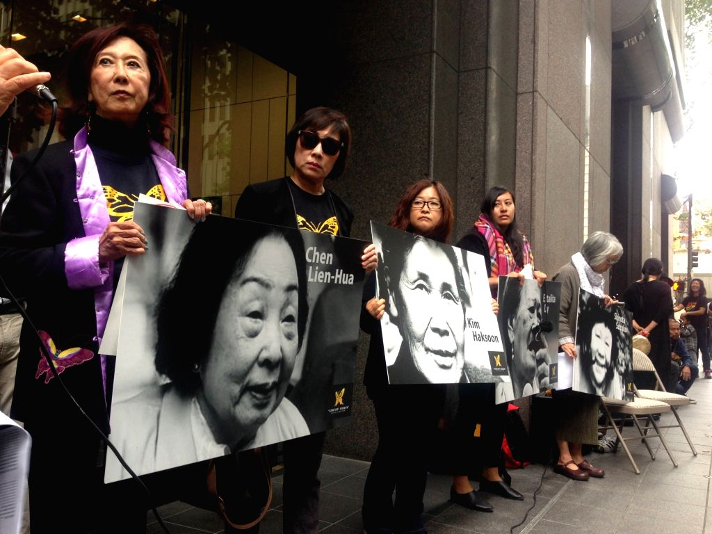 "SAN FRANCISCO, Aug. 14, 2017 - Representatives of grossroots community organizations hold pictures of ""Comfort Women"" during a rally on the sidewalk in front of Japanese Consulate General ..."
