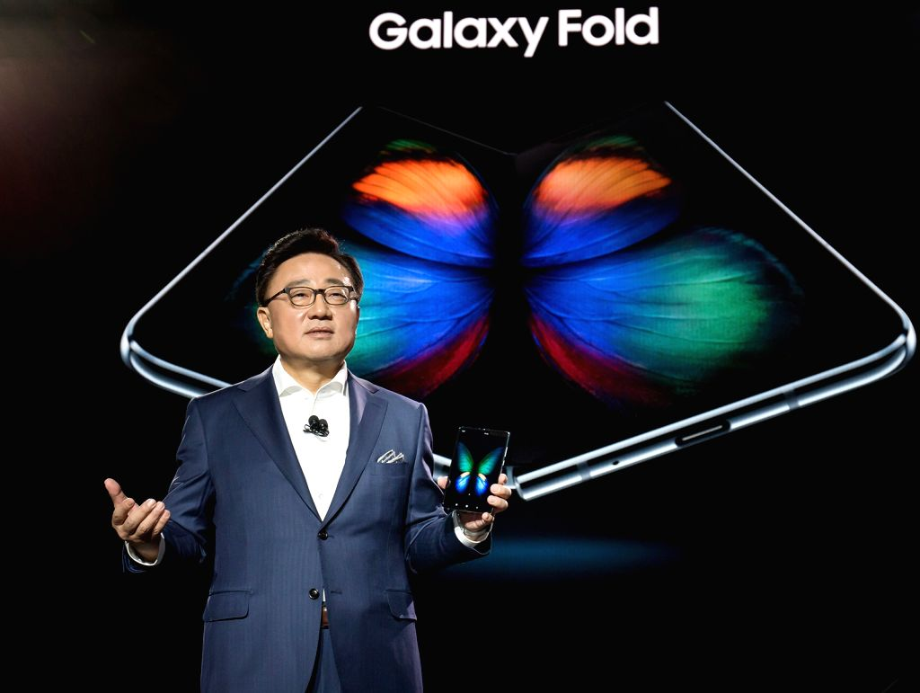 San Francisco: DJ Koh, head of Samsung Electronics Co.'s IT & Mobile Communications Division, unveils the Galaxy Fold, its foldable smartphone, during an Unpacked event in San Francisco on Feb. ...