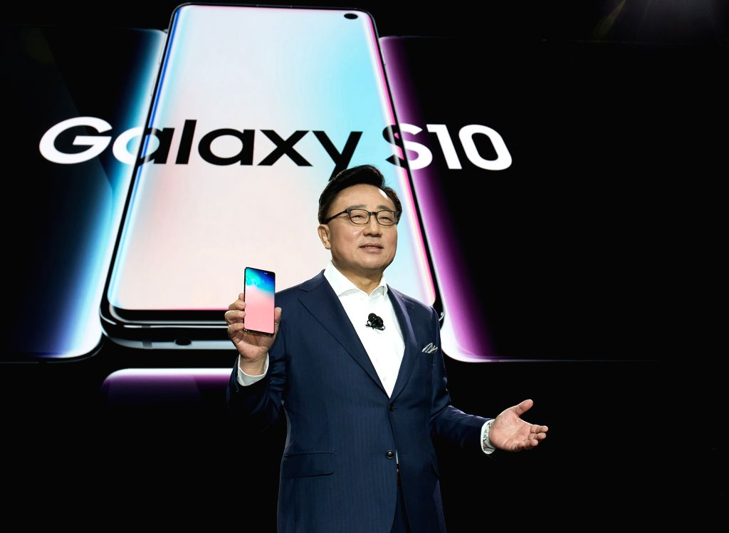San Francisco: DJ Koh, head of Samsung Electronics Co.'s IT & Mobile Communications Division, introduces the new Galaxy S10+ smartphone during an Unpacked event in San Francisco on Feb. 20, 2019, ...