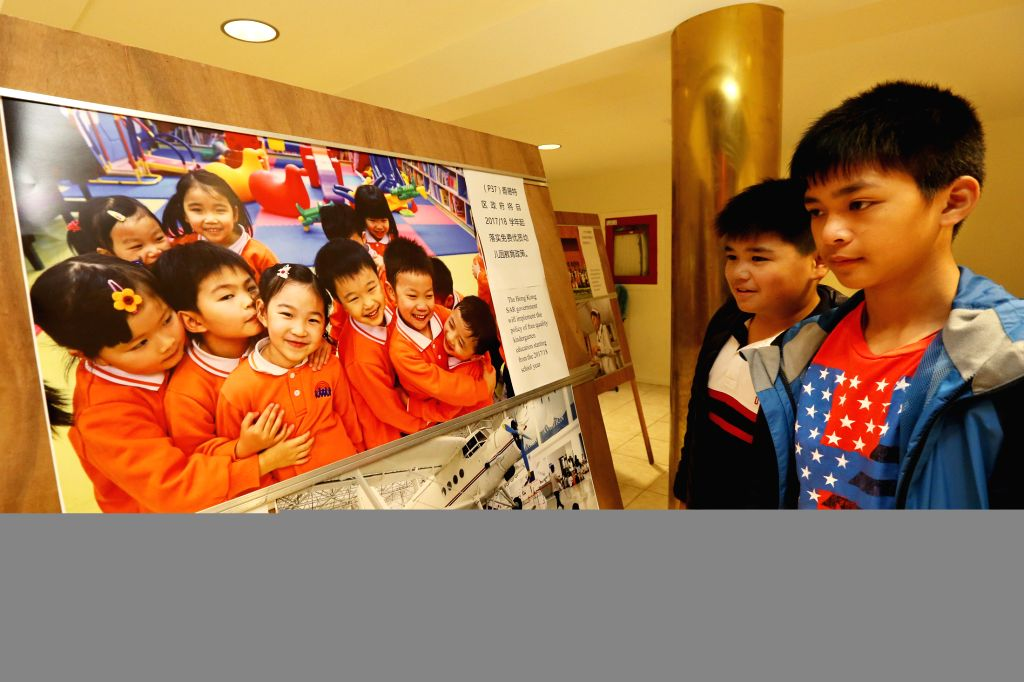 SAN FRANCISCO, June 25, 2017 - Students watch a photo exhibition marking the 20th anniversary of Hong Kong's return to China in San Francisco, the United States, June 24, 2017. The show displayed ...