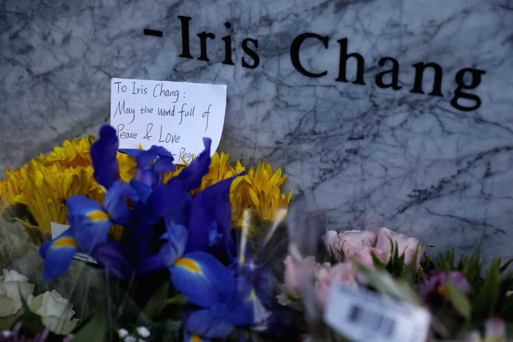 SAN FRANCISCO, Nov. 10, 2019 - Photo taken on Nov. 9, 2019 shows a written message and flower bouquets presented to Iris Chang at a memorial park named after the late Chinese-American writer in San ...