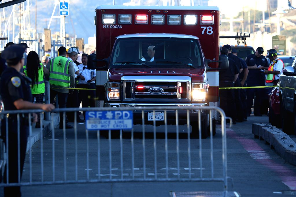 SAN FRANCISCO, Oct. 9, 2016 - A fire engine dispatched by San Francisco Fire Department for the rescue is seen near the water area where an accident happened in San Francisco, the United States, Oct. ...