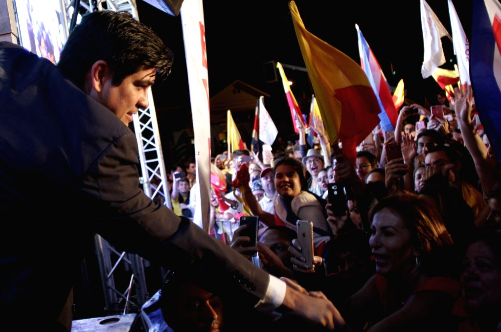SAN JOSE, April 2, 2018 - Costa Rican presidential candidate Carlos Alvarado (L) shakes hands with his supporters in San Jose, Costa Rica, on April 1, 2018. Carlos Alvarado, the candidate from the ...