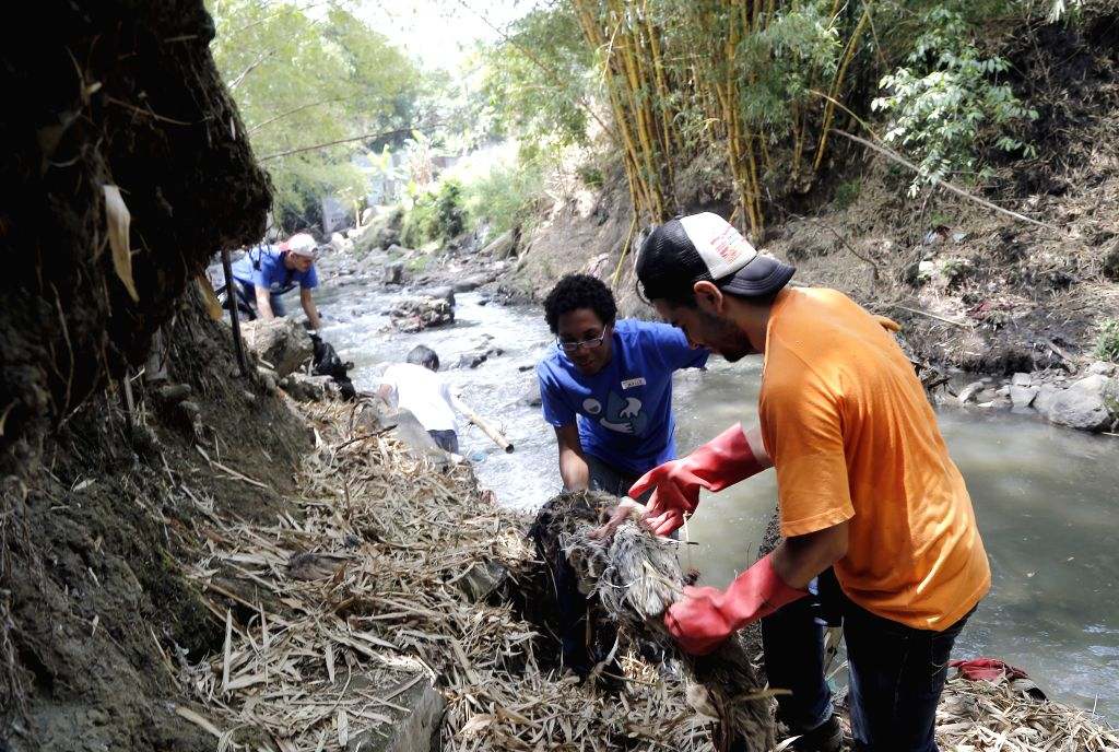 SAN JOSE, April 23, 2017 - Volunteers clean the Torres River on the World Earth Day in San Jose, capital of Costa Rica, on April 22, 2017. World Earth Day is celebrated yearly on April 22.