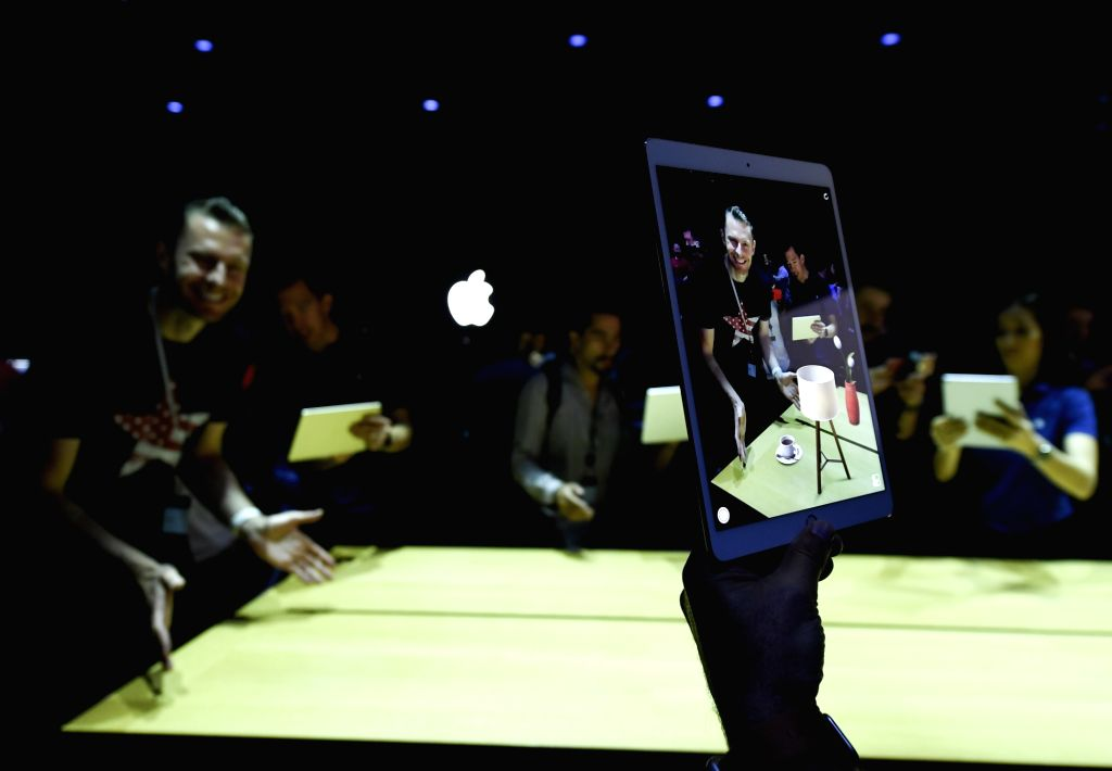 SAN JOSE, June 6, 2017 - People try iPad Pro during an event to announce new products at the Worldwide Developers Conference (WWDC) in San Jose, California, the United States, on June 5, 2017. Apple ...