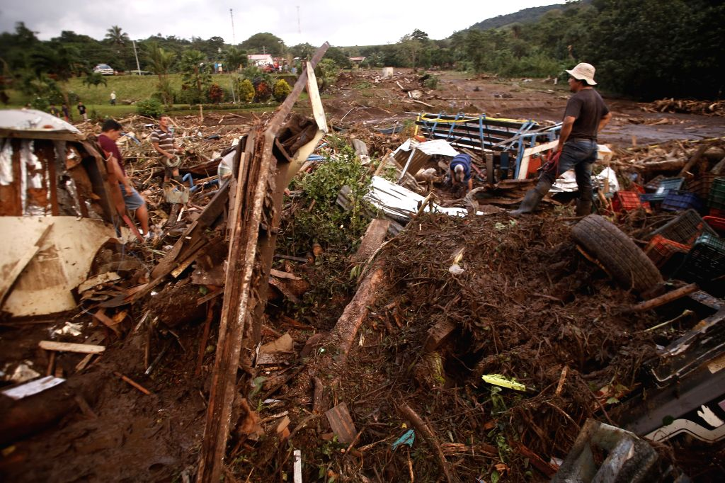 SAN JOSE, Nov. 26, 2016 - People search for the survivors in Upala of Alajuela, Costa Rica, Nov. 25, 2016. The government of Costa Rica confirmed Friday that Hurricane Otto had killed at least nine ...