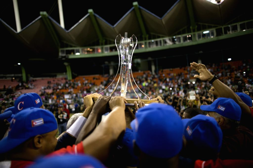 Players of Vegueros de Pinar del Rio of Cuba celebrate with the trophy after the final match of the 2015 Caribbean Series against Tomateros de Culiacan of Mexico at