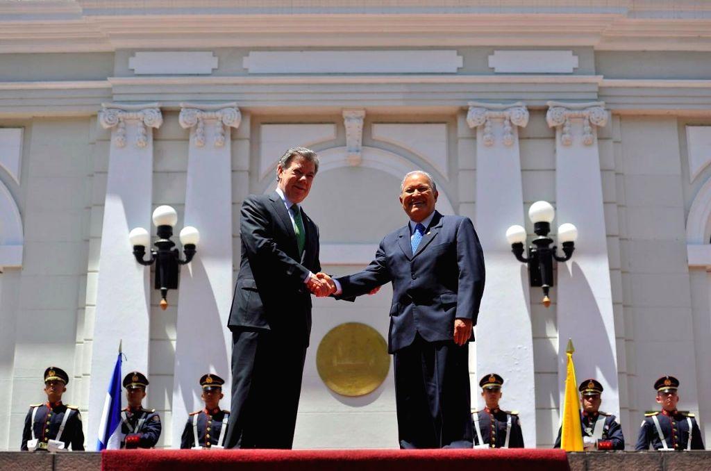 SAN SALVADOR, April 6, 2016 - El Salvador's President Salvador Sanchez Ceren (R) shakes hands with his Colombian counterpart Juan Manuel Santos during a welcoming ceremony in San Salvador, capital of ...