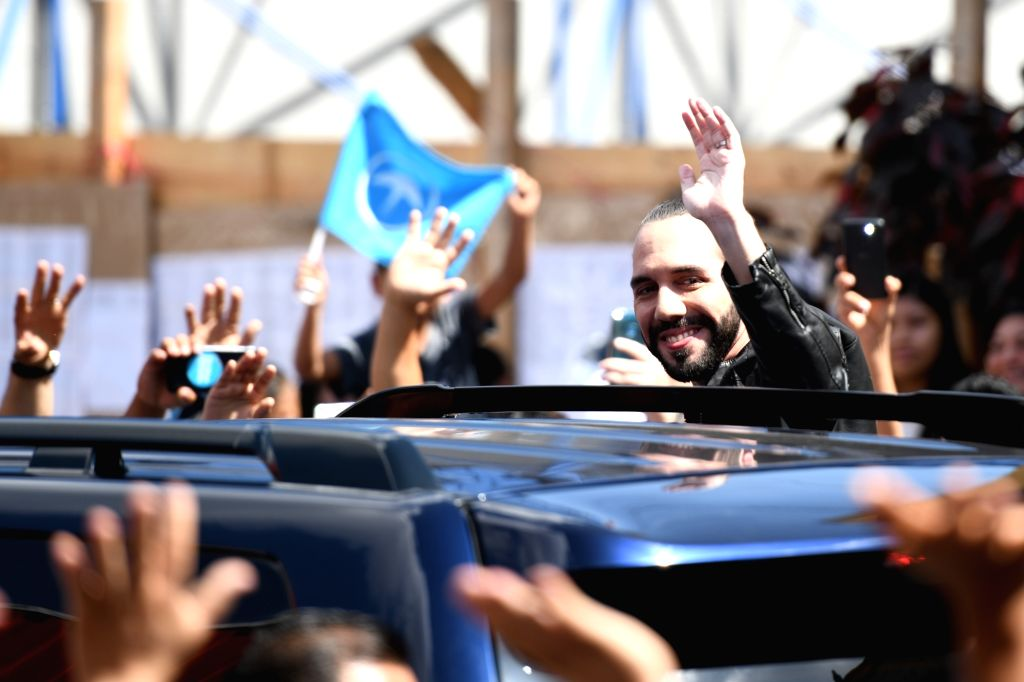 SAN SALVADOR, Feb. 3, 2019 - Presidential candidate Nayib Bukele of the Grand Alliance for National Unity (GANA) waves to supporters at a polling station, in San Salvador, El Salvador, Feb. 3, 2019. ...
