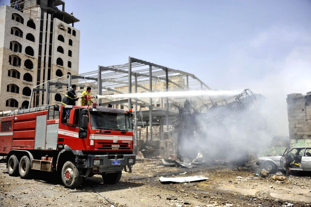 A fire truck puts out fire in civilian areas in Sanaa, Yemen, on April 20, 2015. At least 60 people were killed and 49 others wounded in Yemen's capital of Sanaa on ...