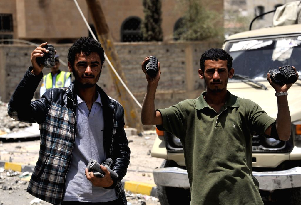 People show shrapnels in civilian areas in Sanaa, Yemen, on April 20, 2015. At least 60 people were killed and 49 others wounded in Yemen's capital of Sanaa on ...