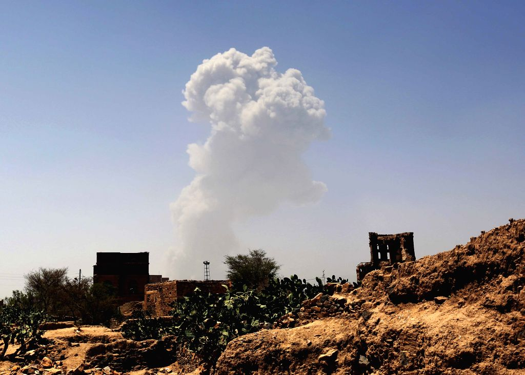 Smoke rises from a military base which is hit by Saudi-led airstrikes in Sanaa, Yemen, on April 20, 2015. At least 60 people were killed and 49 others wounded in ...