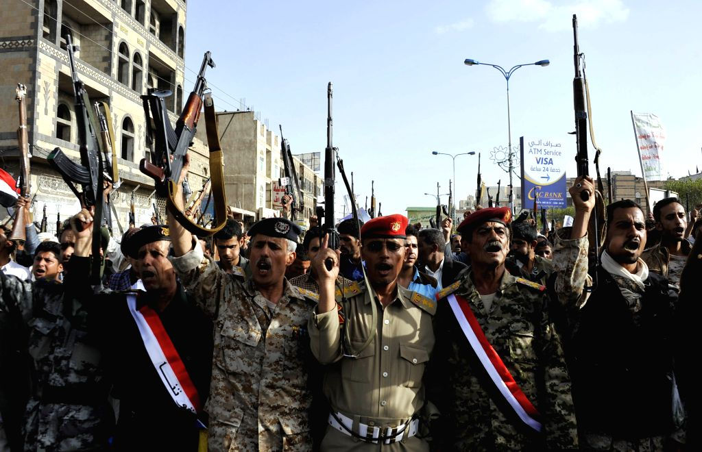 Protesters shout slogans during a demonstration in Sanaa, Yemen, on April 27, 2015, to denounce the Saudi-led airstrikes. Tens of thousands of supporters of the ...