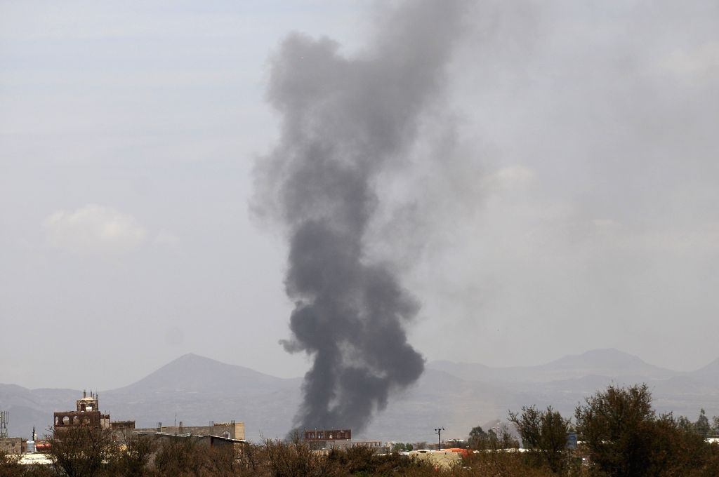 SANAA, April 5, 2018 - Photo taken on April 5, 2018 shows smoke rising after airstrikes of the Saudi-led coalition warplanes targeted a weapon depot of the Houthi rebels in Sanaa, Yemen.