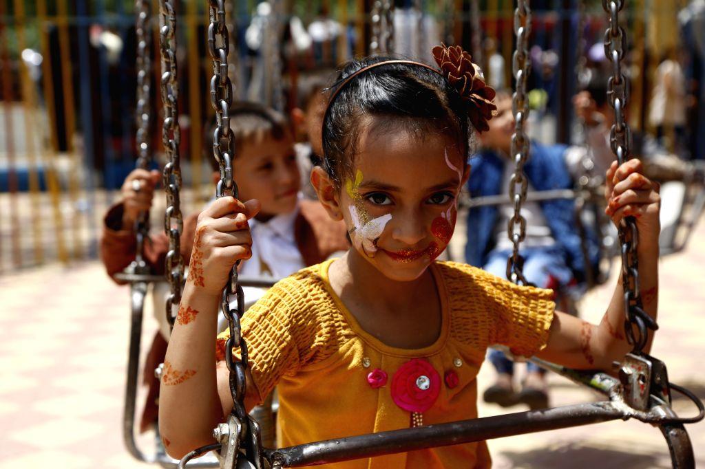 SANAA, Aug. 13, 2019 - Yemeni children enjoy the Eid al-Adha holiday at an amusement park in Sanaa, Yemen, Aug. 13, 2019.